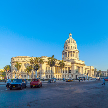 HAVANA, CUBA - APRIL 1, 2012: Heavy traffic with vintage cars in front of Capitolio Editorial