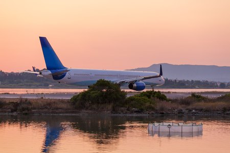 Airplane on runway before take off in airport of Corfu Editorial