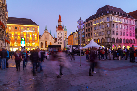 Munich, Germany - October 14, 2017: Night view of tourists near New Town Hall (Neues Rathaus) on Marienplatz
