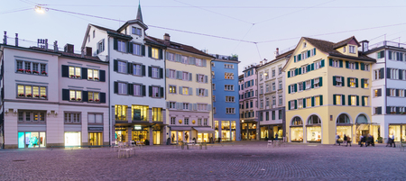 Panoramic view of Munsterhof square with old Guild houses at night, Zurich, Switzerland