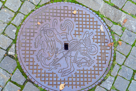 A manhole cover with saint George coat of arms, Stein am Rhein, Schaffhausen, Switzerland Editorial