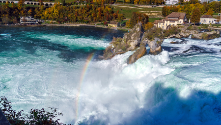 The Rhine Falls near Zurich at Indian summer, largest waterfall in Switzerland