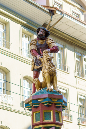 Samson killing a lion, One of the famous Renaissance fountains (XVII c.) in the center of the old city, Bern, Switzerland