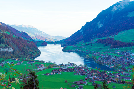 Valley of Lake Lungern or Lungerersee with traditional Alps chalets in Obwalden, Switzerland