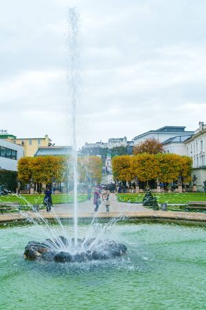 Salzburg, Austria - October 21, 2017: Fountains of Mirabell garden and Hohensalzburg Castle, former Residenz of Archbishop 에디토리얼