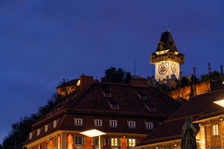 The Schlossberg or Castle Hill with the clock tower Uhrturm at night, Graz, Austria Editorial
