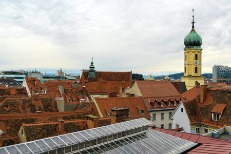 Franziskanerkirche and red roofs of old city aerial view, Graz, Austria Stock Photo