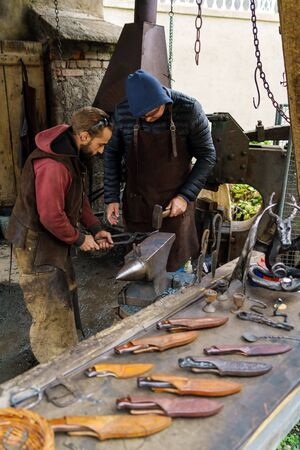 Graz, Austria - October 23, 2017: Demonstrative performance of a blacksmith in Riegersburg Castle and hand-forged knives