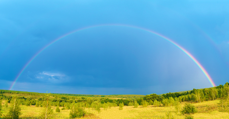 Beautiful nature landscape with double full rai5nbow above farm field panorama
