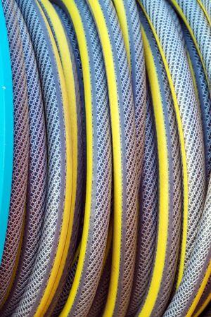 Close-up of garden hose reel for irrigation and landscape design 版權商用圖片