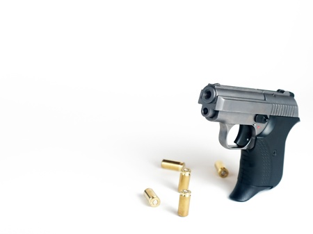 Five bullets and handgun with place for text Stock Photo - 11573219
