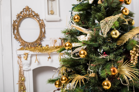 mantelpiece: christmas decorated room with a tree and a mantelpiece