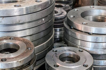 Flanges of different sizes in the workshop of the plant Stock Photo