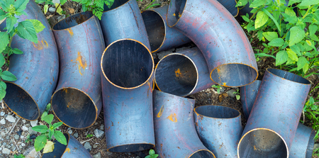 flanges: Corner metal pipes of boiler system on the grass