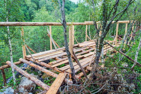 rafters: Installation of wooden beams from logs at construction house