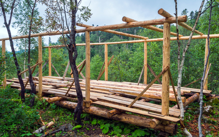 joists: Installation of wooden beams from logs at construction house