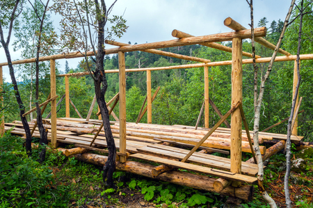 wooden beams: Installation of wooden beams from logs at construction house