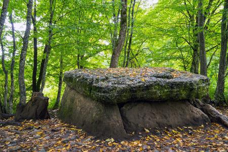 Ancient dolmen in field autumn in Adygeya