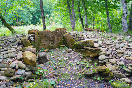 The stones of the destroyed ancient dolmen in Adygea in southern Russia