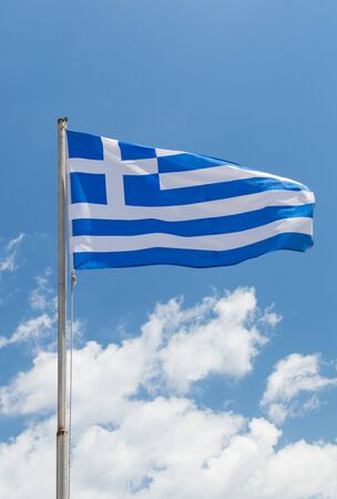 the european economic community: National flag of Greece in the wind. Blue sky with white clouds on background.