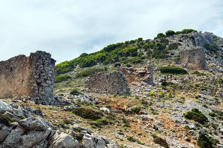 past civilization: Ruins of ancient bridge in mountains on Crete island, Greece Stock Photo