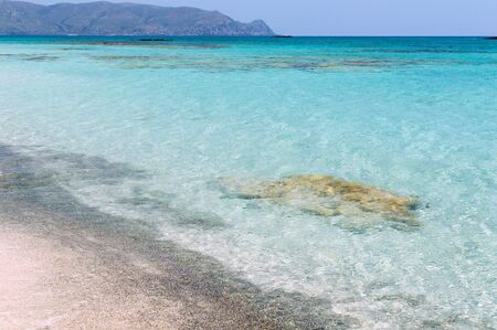 azure coast: Coast of Crete island in Greece. Sandy beach with transparent clean water azure color