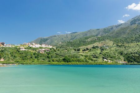Color water of lake Kournas at Crete island in Greece. Panoram view Stock Photo