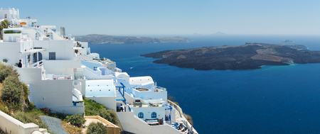 Nea Kameni volcanic island in Santorini Greece with ships in front photographed from a high point of view