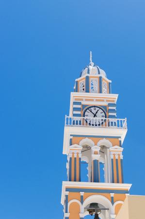 greek islands: Clock Tower in the village of Thira, Santorini, in the Greek Islands Stock Photo