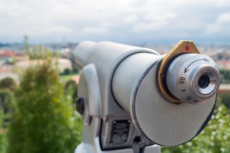 Touristic telescope look at the city with view of Prague, closeup grey monoscope on background viewpoint, coin operated in panorama observation nature