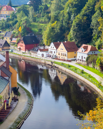 waterfront property: Idyllic autumnal life in Cesky Krumlov, Czech Republic. Typical small old european houses on the bank of river Vltava Stock Photo