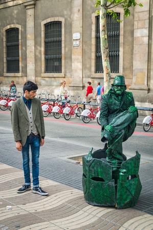 Barcelona, Spain - June 24, 2013: Street performer, live statue at La Ramblas street.