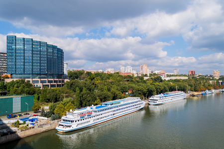Cruise ship moored to the embankment in Rostov-on-Don, South Russia. Against the background of the panorama of the city on seven hills. View from the Voroshilovskiy bridge.