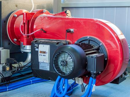 Modern boiler room equipment- high power boiler burner. Boiler room. Water heating. Power supply. Water supply. Stock Photo
