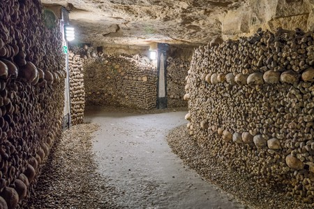 Old catacombs. Tunnels, walls made of bones and skulls