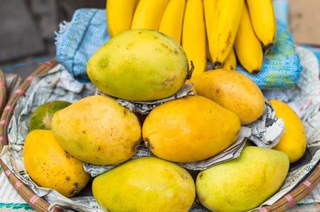 Fresh fruit market in Asia. Mango in the bucket. Exotic street food