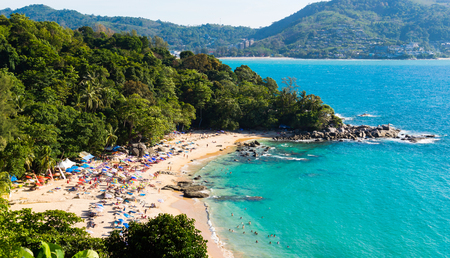 Aerial view of the Kamala beach on the Phuket island in Thailand. Many people rest on beach sand and in the sea. 版權商用圖片