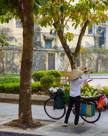 Street vendor transporting and selling goods in the streets of Hanoi, Vietnam