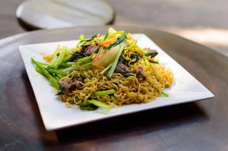 Chinese food - Beef lo mein meal on white square plate Stock Photo