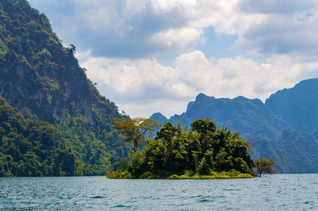 Beautiful mountains lake river sky and natural attractions in Ratchaprapha Dam at Khao Sok National Park, Surat Thani Province, Thailand.
