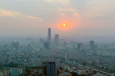 Hanoi skyline cityscape at twilight period. Air pollution in the big city. Smog over in the air. 写真素材