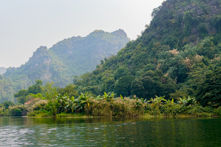 Trang An, Tam Coc, Ninh Binh, Vietnam. renowned for its boat cave tours by the river.