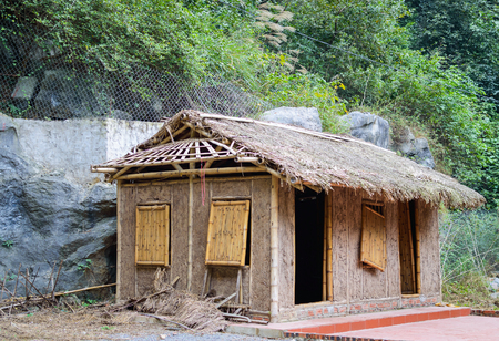 Traditional asian hut or house made from mud and natural materials and thatched roof