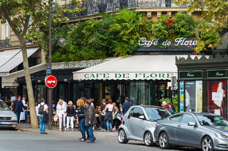 The cafe De Flore is one of the oldest cafe in Paris, located in 6th arrondissement.It was associated with Jean Paul Sartre, , Albert Camus, Pablo Picasso. Paris, France, October, 04, 2014