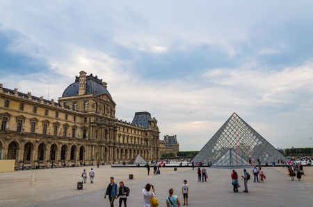 View on the Louvre museum square with people during the cloudy weather. France, October 04, 2014. Editorial