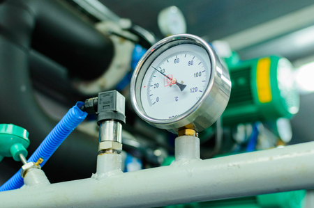 Thermometer in pipeline system industry focus close up.