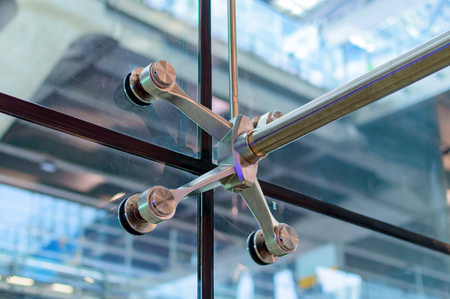 Metal mount with fasteners elements of spider glass system for glass walls