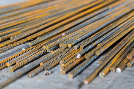 Stack of construction steel rod armature. Selective focus, Stock Photo