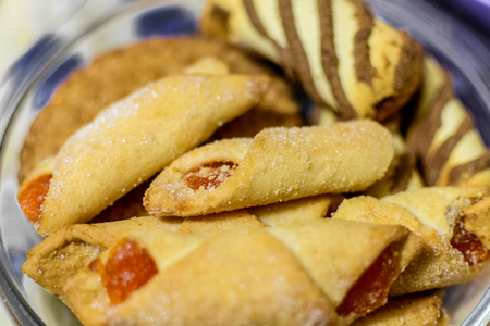 Fresh baked homemade cookies with sugar and jam.