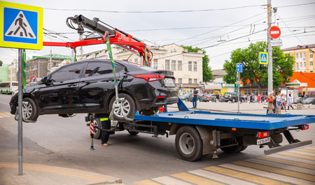 Rostov-on-Don, Russia - May 18, 2018: traffic police on the street pick up a car that violates the rules of parking on the tow truck picks up.